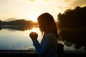 woman-praying-profile-featured-w740x493