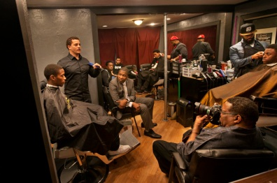Barber Dave Diggs makes a point during one of the open-to-all and raw conversations had by young and old black men at Barber Inc. in downtown San Jose, Calif., Thursday, April 2, 2014. The gatherings are inspired by The Barbershop Diaries, a film by a San Jose State University professor, Michael Cheers. In the film, barbers discuss their lives and how the shops became part of their survival landscape. Now, six discussions are following, all while barbers are cutting heads of real customers. (Patrick Tehan/Bay Area News Group)