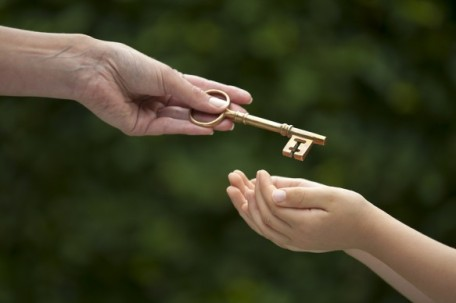 bigstock-adult-hands-key-to-child-44532022-583x388