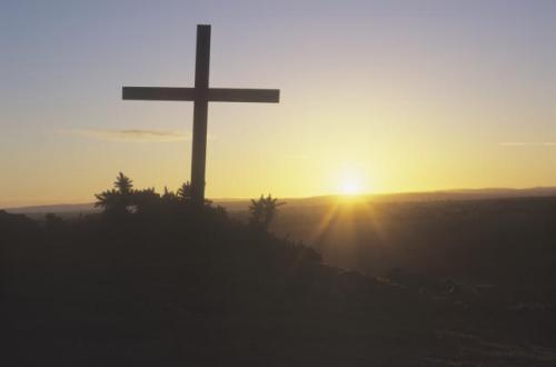 Cross and sky, sunrise (sun flare)